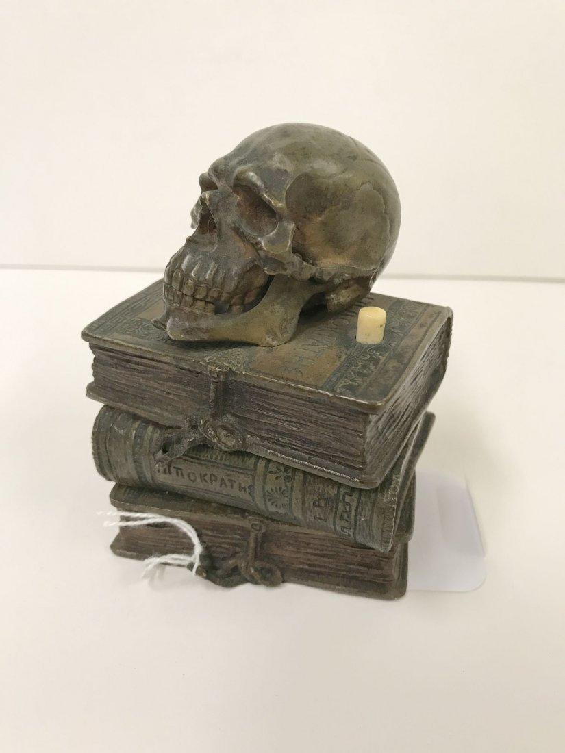 Bronze Skull on Stacked Books