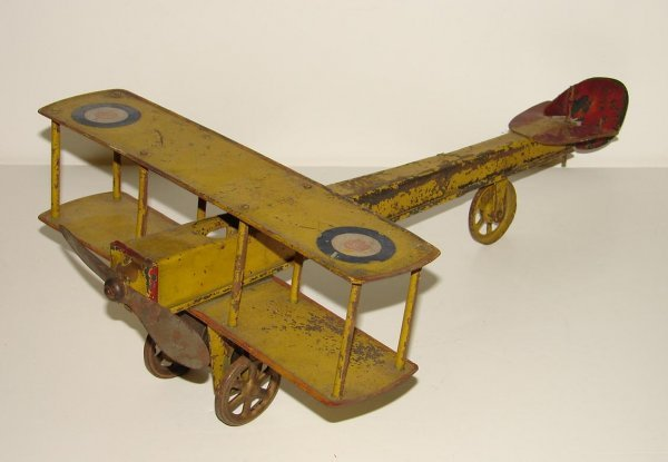 3017: EARLY AND RARE. PRESSED STEEL AIRPLANE.