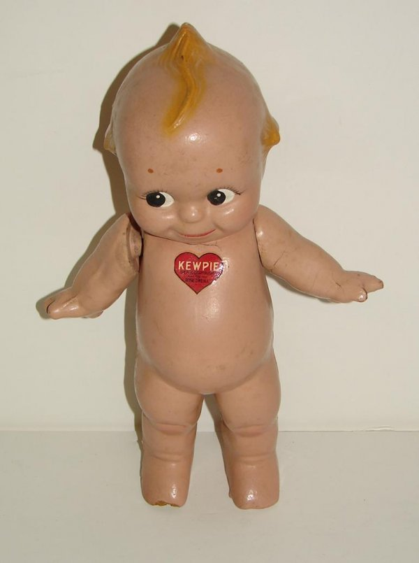 """3022: 11"""" COMPOSITION KEWPIE WITH WINGS."""
