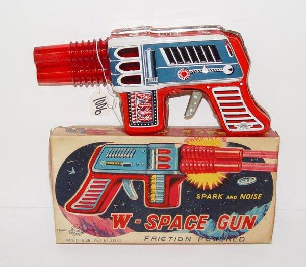 1006: BOXED TIN LITHO FRICTION SPARK SPACE GUN