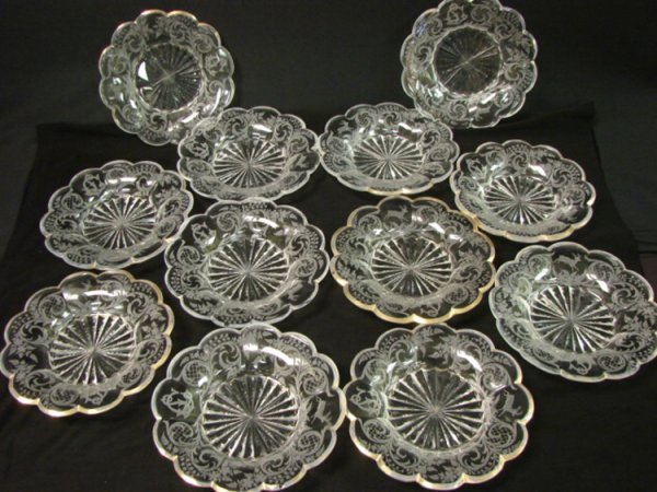 21: LOT OF 12 ETCHED AND GILDED GLASS PLATES