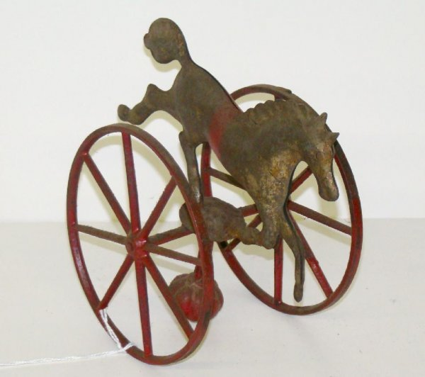 1198: EARLY WEIGHTED HORSE TOY.