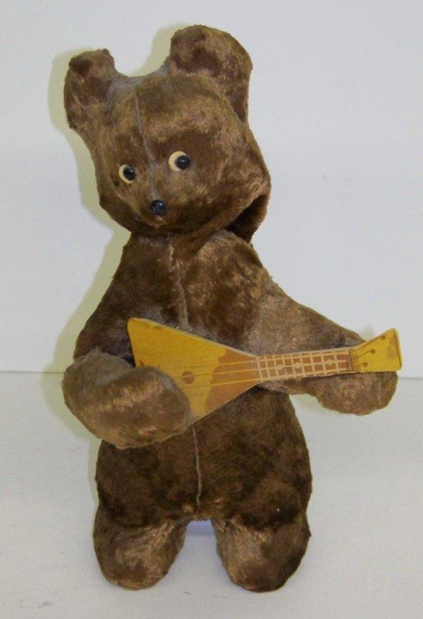 2423: GERMAN. WIND UP GUITAR PLAYING BEAR.