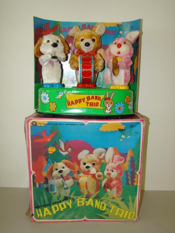 12: BOXED MODERN TOYS BATTERY OP HAPPY BAND TRIO