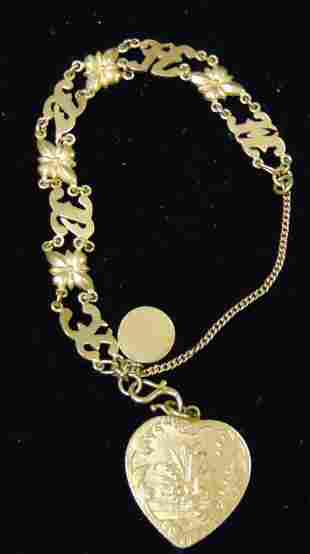High Karat Gold Bracelet with Charms.