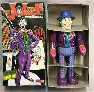 Boxed Tin Litho Mechanical Joker Billiken