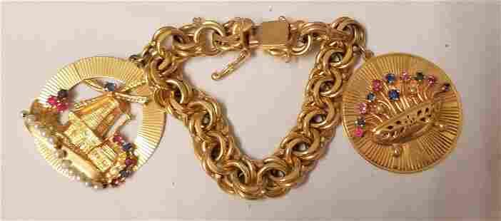 14 K Yellow Gold Charm Bracelet.