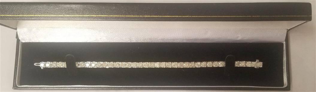 10K White Gold And Diamond Tennis Bracelet.