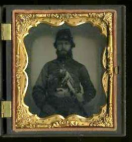 17: ARMED IMAGE. TINTYPE.
