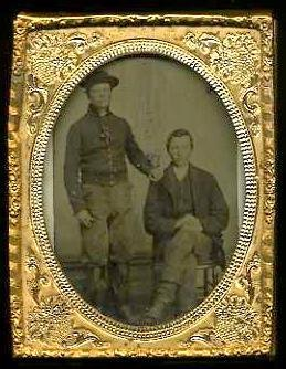 18: TINTYPE OF TWO WESTERN CAVALRY SOLDIERS.