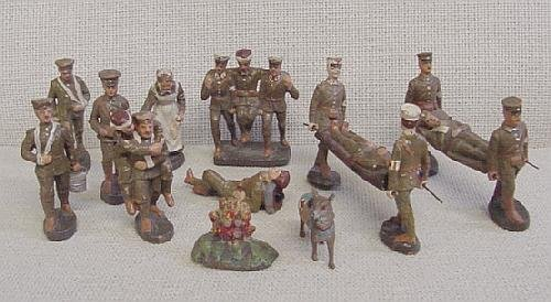 13: 11 Elastolin Wounded Toy Soldiers