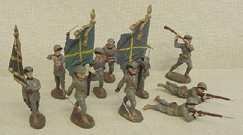 24: Lot of 12 Elastolin Foreign Soldiers