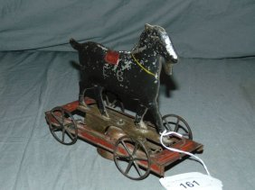 Early Tin Goat On Platform Bell Toy