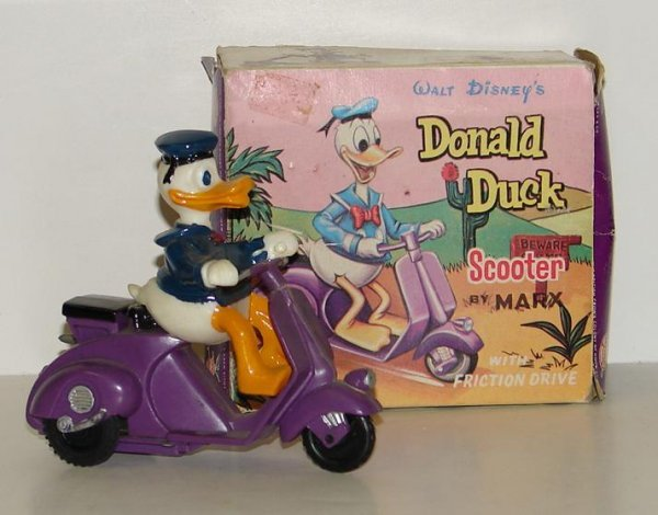 4002: VINTAGE DONALD DUCK ON SCOOTER IN BOX