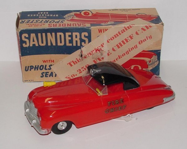 """2002: SAUNDERS.  FRICTION FIRE CHIEF. PLASTIC CAR 10"""" W"""