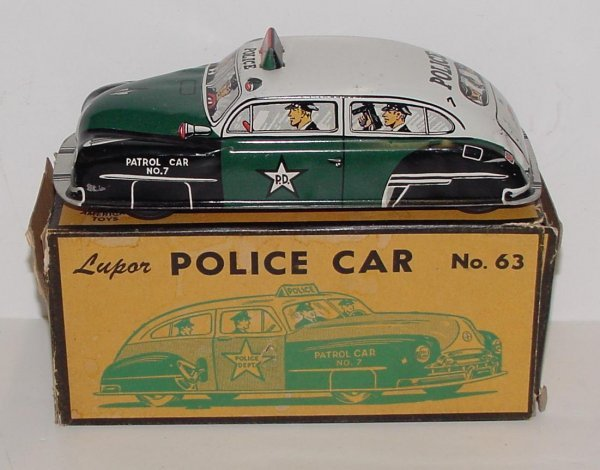 2016: LUPOR WIND UP POLICE CAR WITH BOX TIN LITHO WIND
