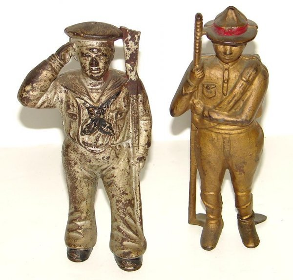 2009: 2 CAST IRON FIGURAL COIN BANKS