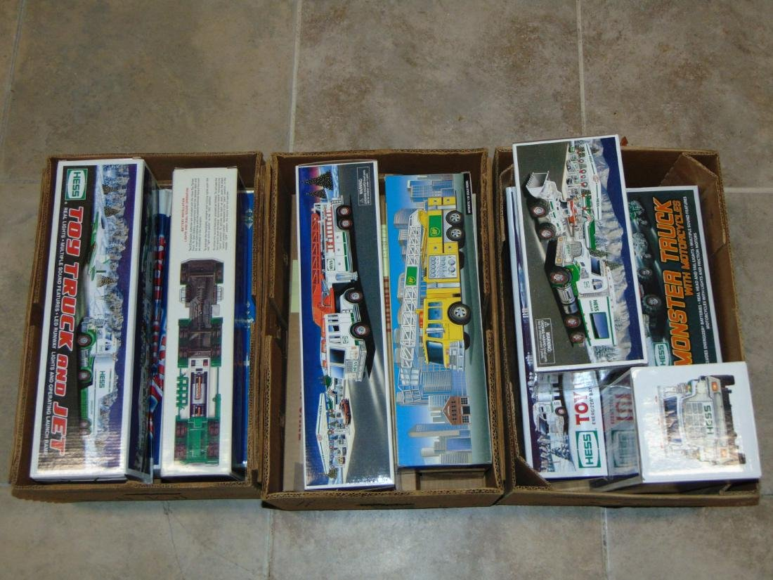 Large Lot of New Hess Toy Trucks & Helicopters