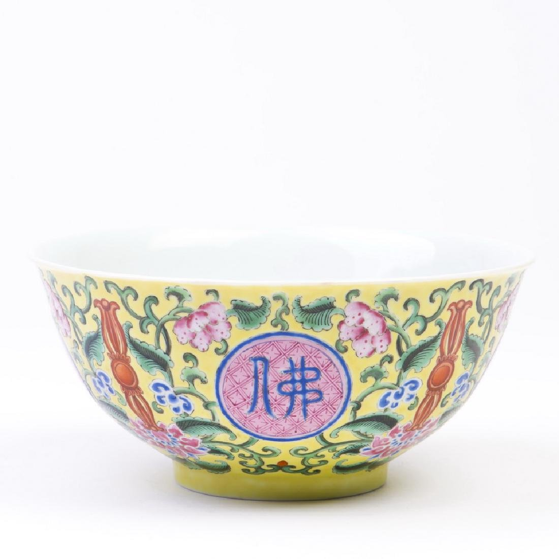 A Yellow Ground Yangcai Floral Bowl with Buddha