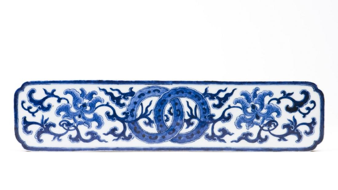 A Blue and White Scroll Weight