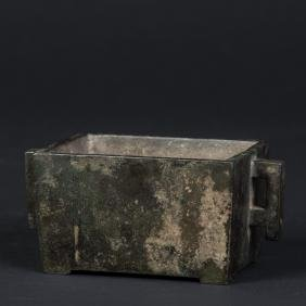 A Chinese Bronze Manger-form Censer