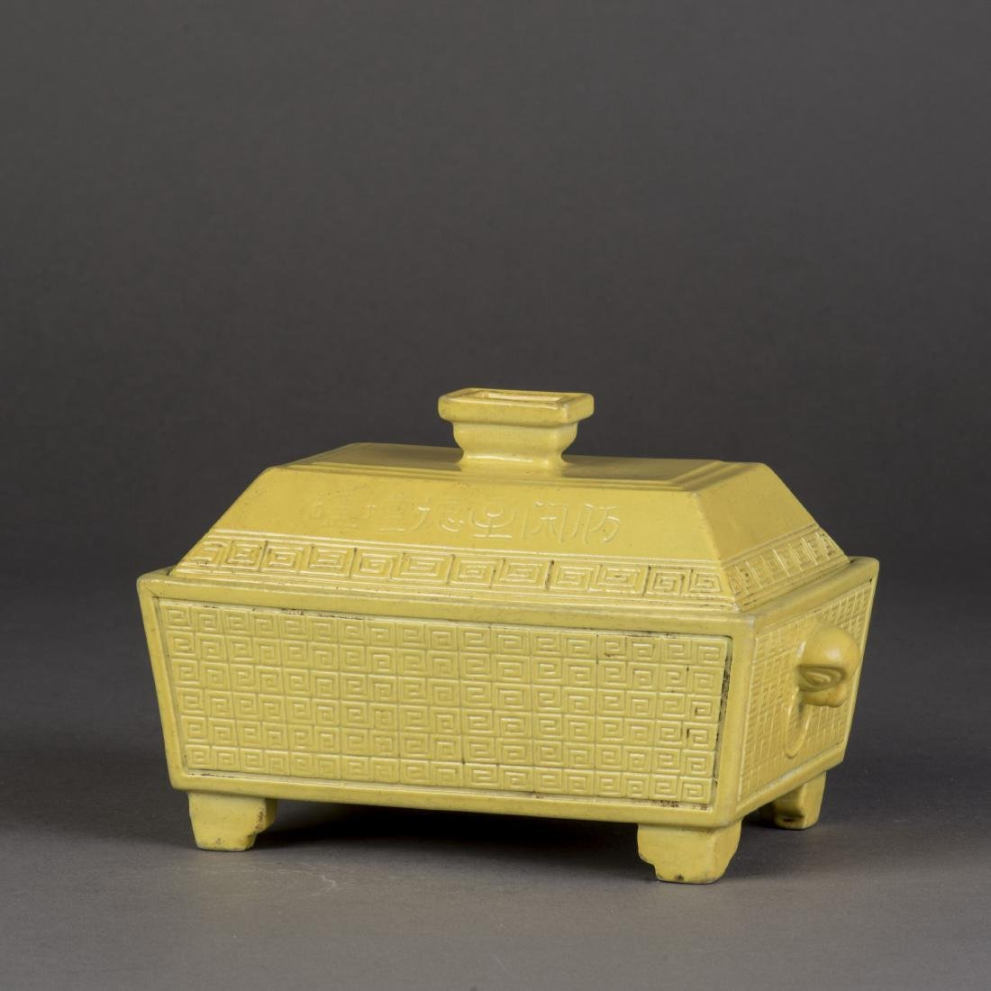 A YELLOW-GLAZED SCROLL PATTERN PORCELAIN CENSER WITH
