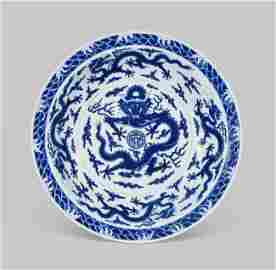 A RARE AND LARGE IMPERIAL BLUE AND WHITE 'DRAGON' DISH