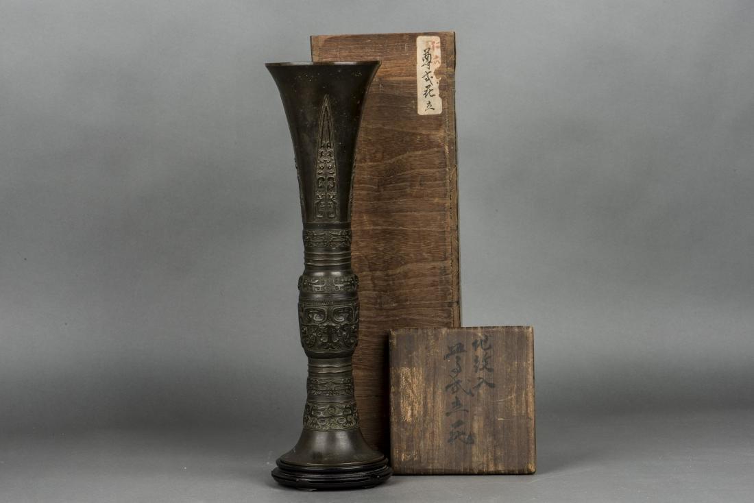 A SHANG STYLE BRONZE BEAKER VASE, 19TH CENTURY