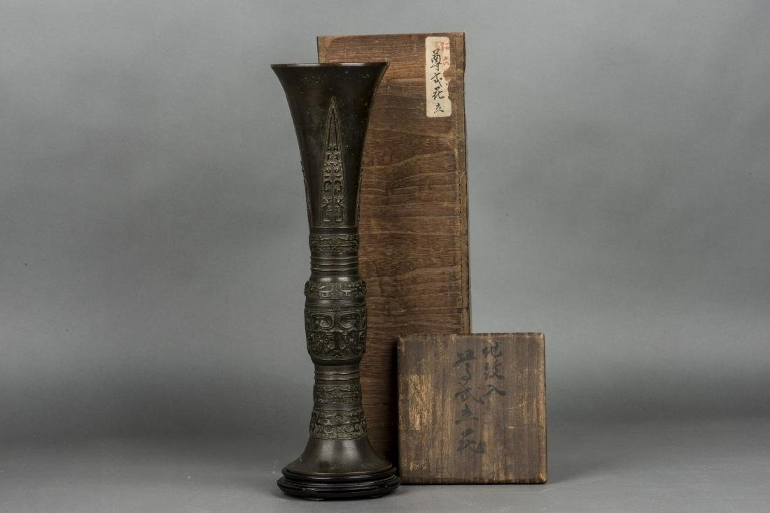 A SHANG STYLE BRONZE BEAKER VASE, 19TH CENTURY