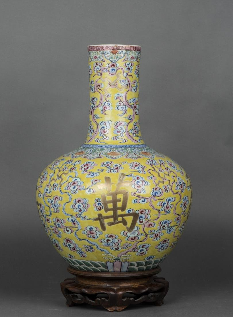 A YELLOW-GROUND FAMILLE ROSE BOTTLE VASE