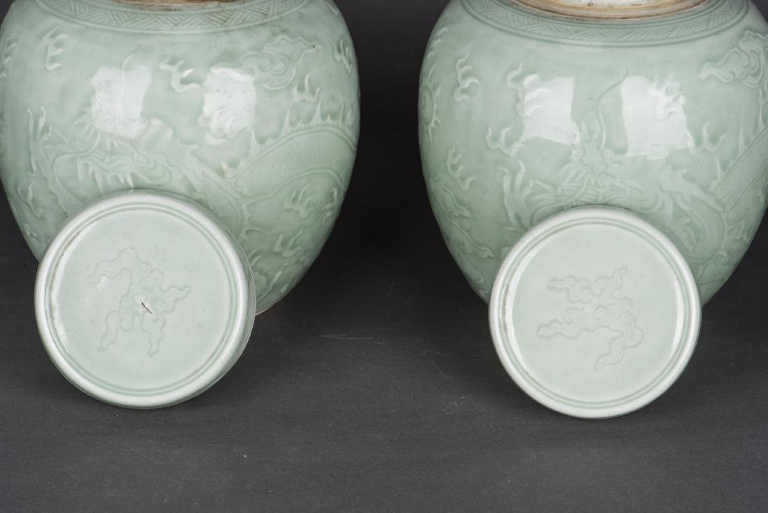 A PAIR OF CELADON-GLAZED 'DRAGON' JAR AND COVERS - 3