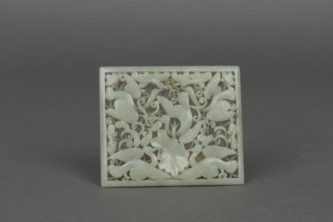 A WHITE JADE 'SWALLOWS' PLAQUE, YUAN DYNASTY