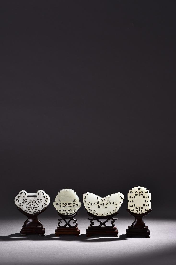 FOUR PIECES OF OPENWORK WHITE JADE