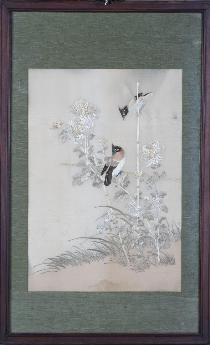 A FRAMED FLOWER AND BIRD EMBROIDERY