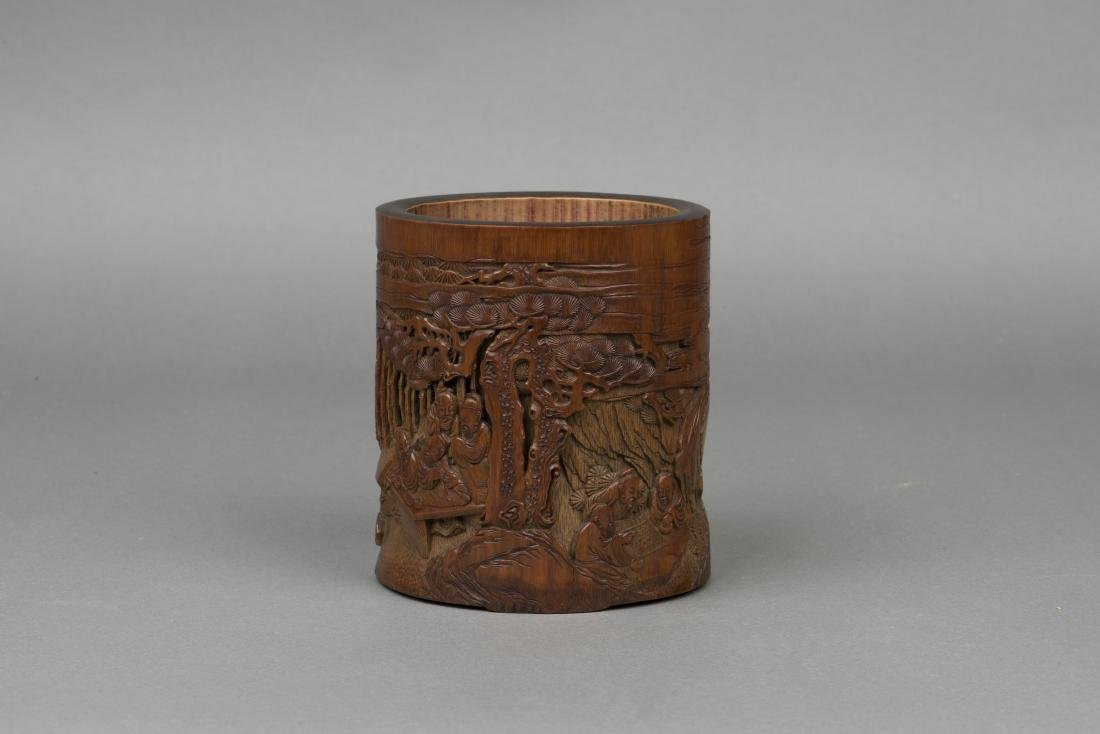 A CARVED BAMBOO 'FIGURAL' BRUSH POT
