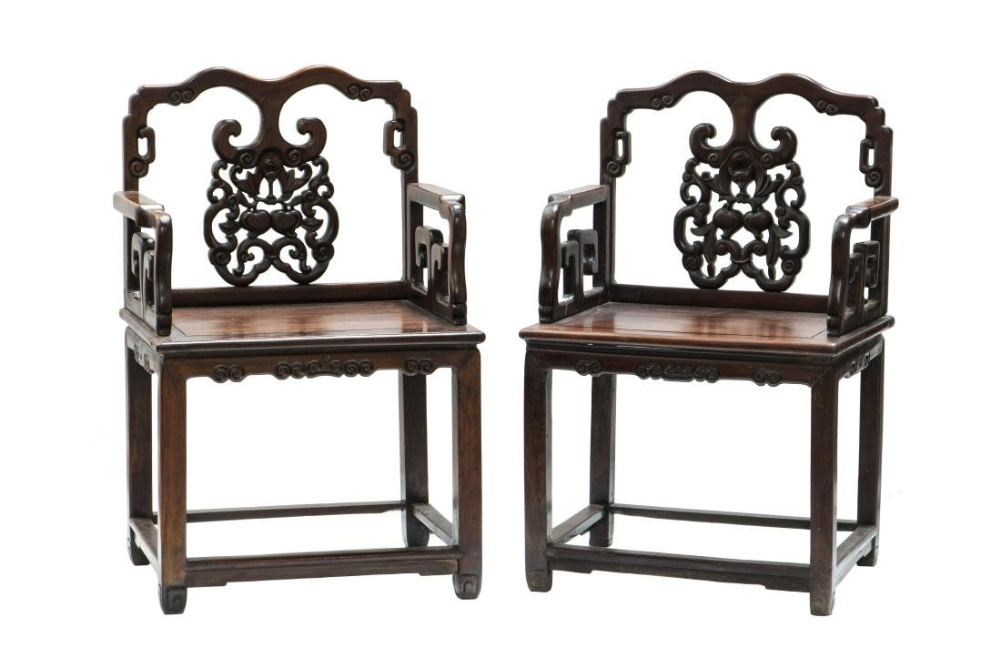 A PAIR OF 'LONGEVITY' ARM CHAIRS