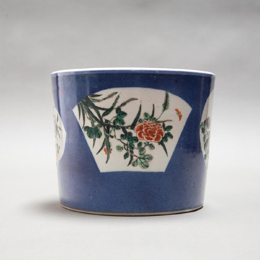 A CHINESE ANTIQUE FAMILLE ROSE BLUE GROUND BRUSH POT