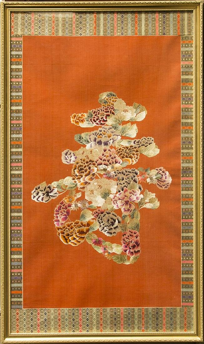 A CHINESE RED-GROUND SILK EMBROIDERY 'SHOU' PANEL