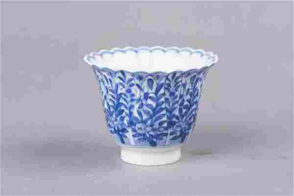 A BLUE AND WHITE CUP