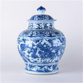 A LARGE BLUE AND WHITE 'FIGURAL' JAR WITH COVER, MING