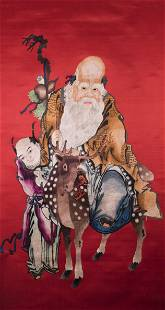 A CHINESE RED-GROUND EMBROIDERED LONGEVITY GOD AND