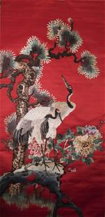 A CHINESE RED-GROUND EMBROIDERED CRANE SILK HANGING