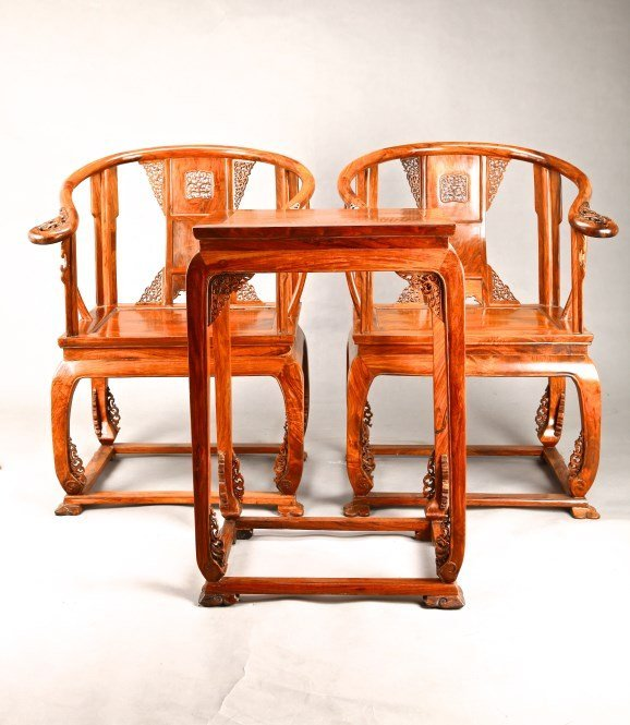 Chinese Carved Huanghuali wood chairs and a tea table