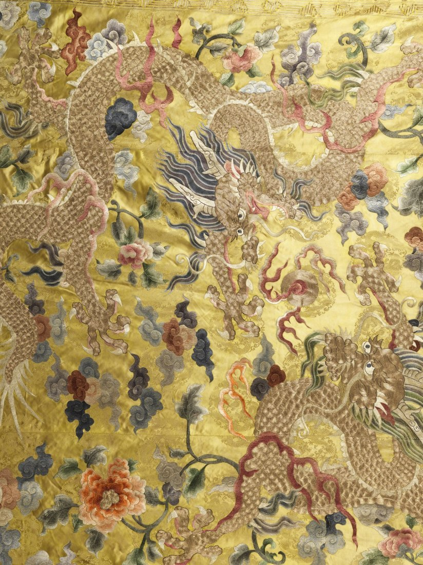 A CHINESE SILK EMBROIDERED BLANKET OVERLAY