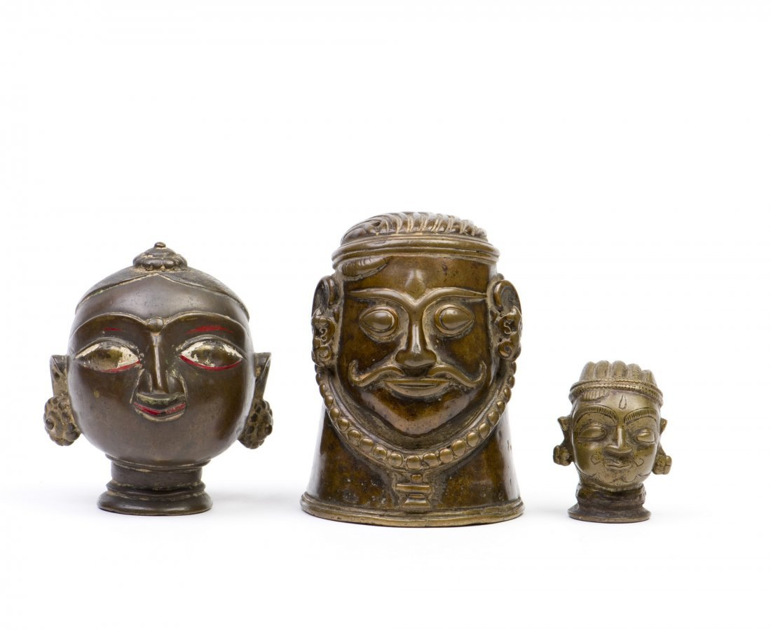 A SET OF THREE INDIAN BRONZE HEAD SCULPTURES