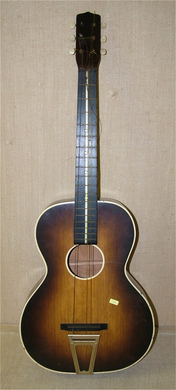 "7010: 6 STRING GUITAR IN CASE 36 1/2""L, NEED SOME STRIN"