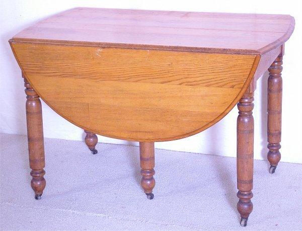 7022: OAK DROP LEAF EXT TABLE W/TURNED LEGS & 3 LEAVES