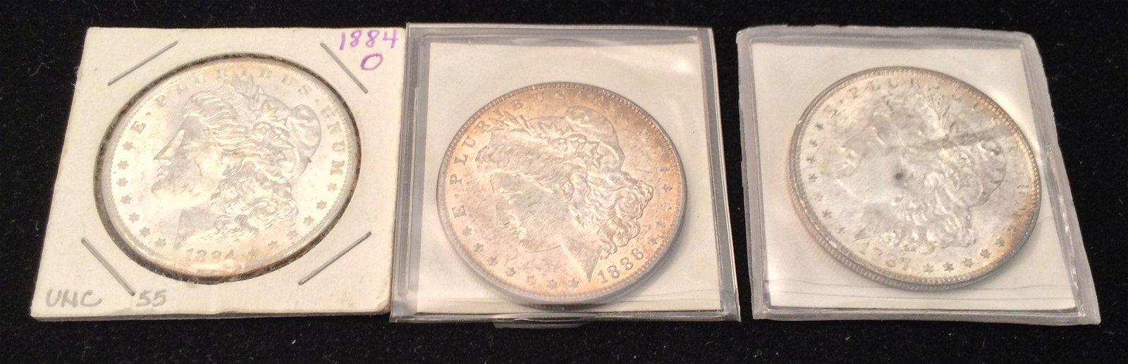 3 MORGAN SILVER DOLLARS INCLUDING 1884O, 1886, AND 1887
