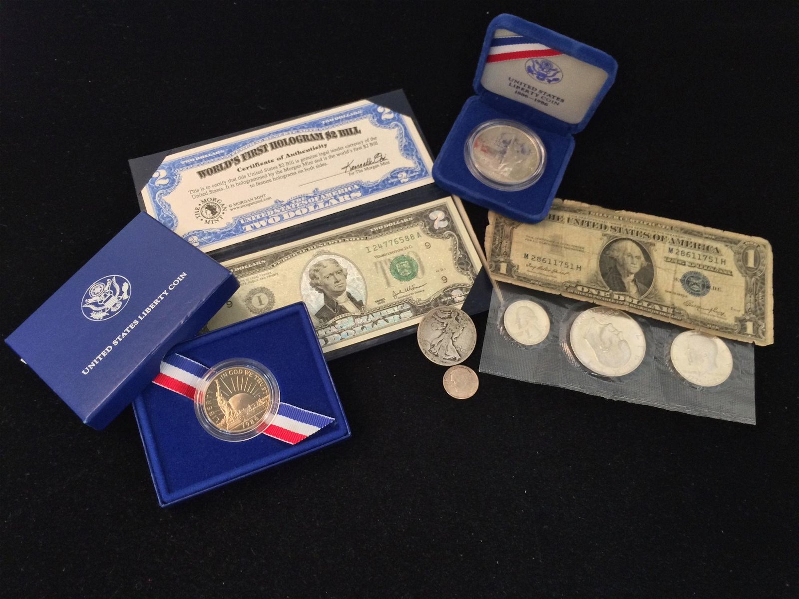 MIXED LOT INCLUDING SERIES 1935 ONE DOLLAR SILVER