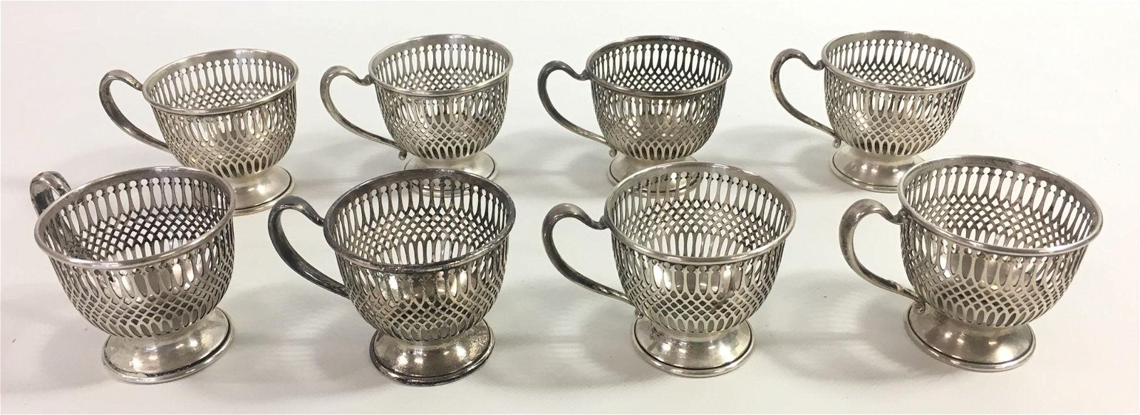 EIGHT STERLING EGG CUPS